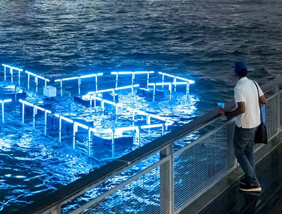 Floating LED sculpture tracks New York water quality.